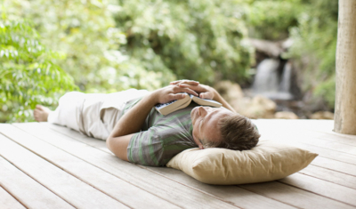 A man resting on a deck